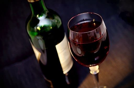 Bottle_and_glass_of_red_wine